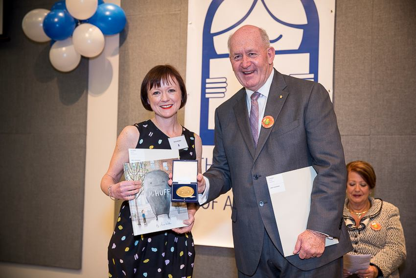Anna Walker accepts her Award form the Governor-General Sir Peter Cosgrove