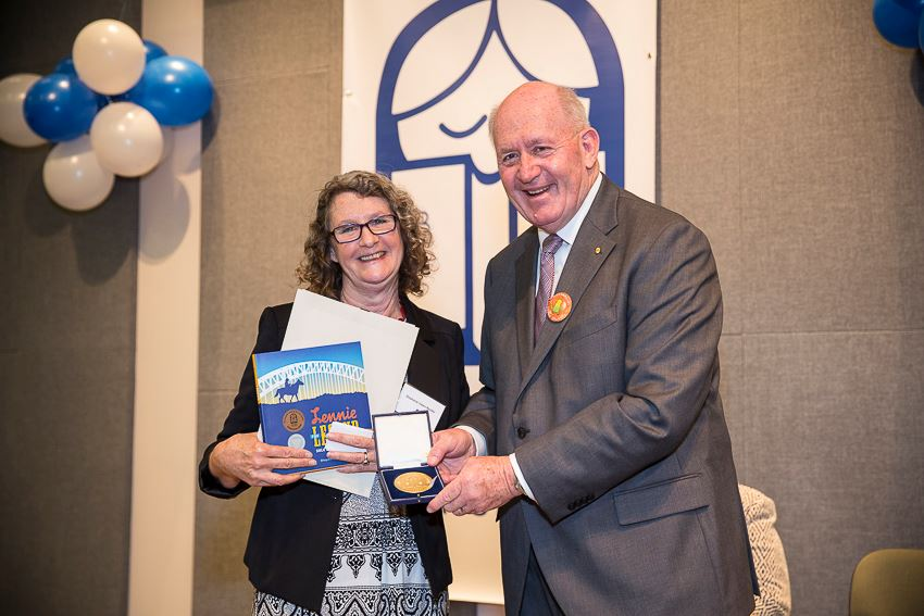 Dr Stephanie Owen Reeder accepts her Award from Governor-General Sir Peter Cosgrove
